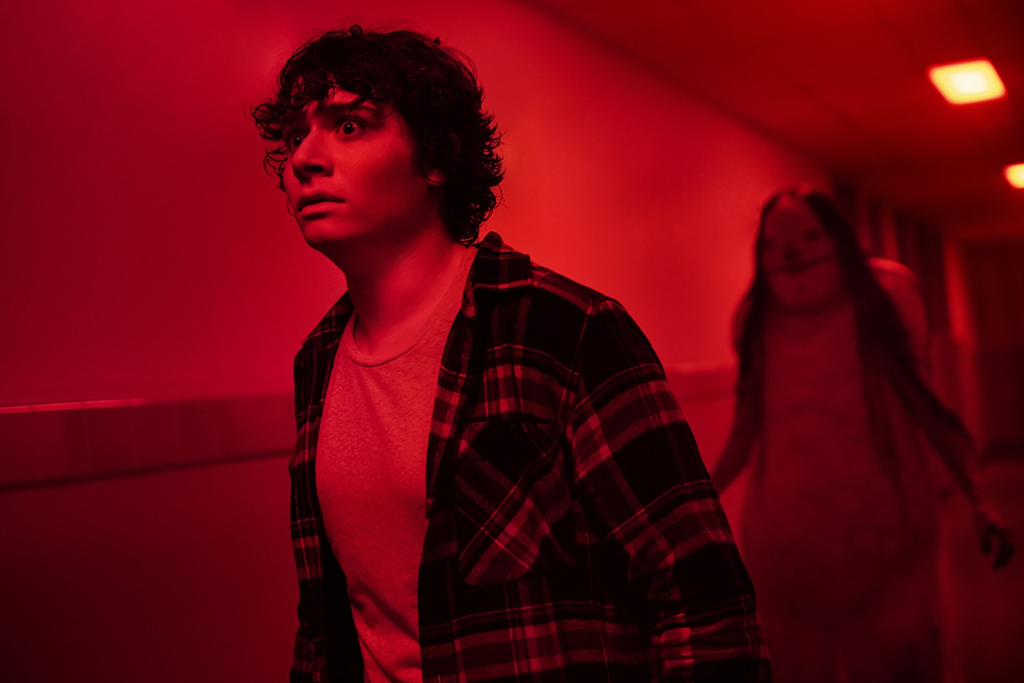 Chuck (Austin Zajur) runs from the Pale Lady in 'Scary Stories to Tell in the Dark' (Courtesy: CBS Films)