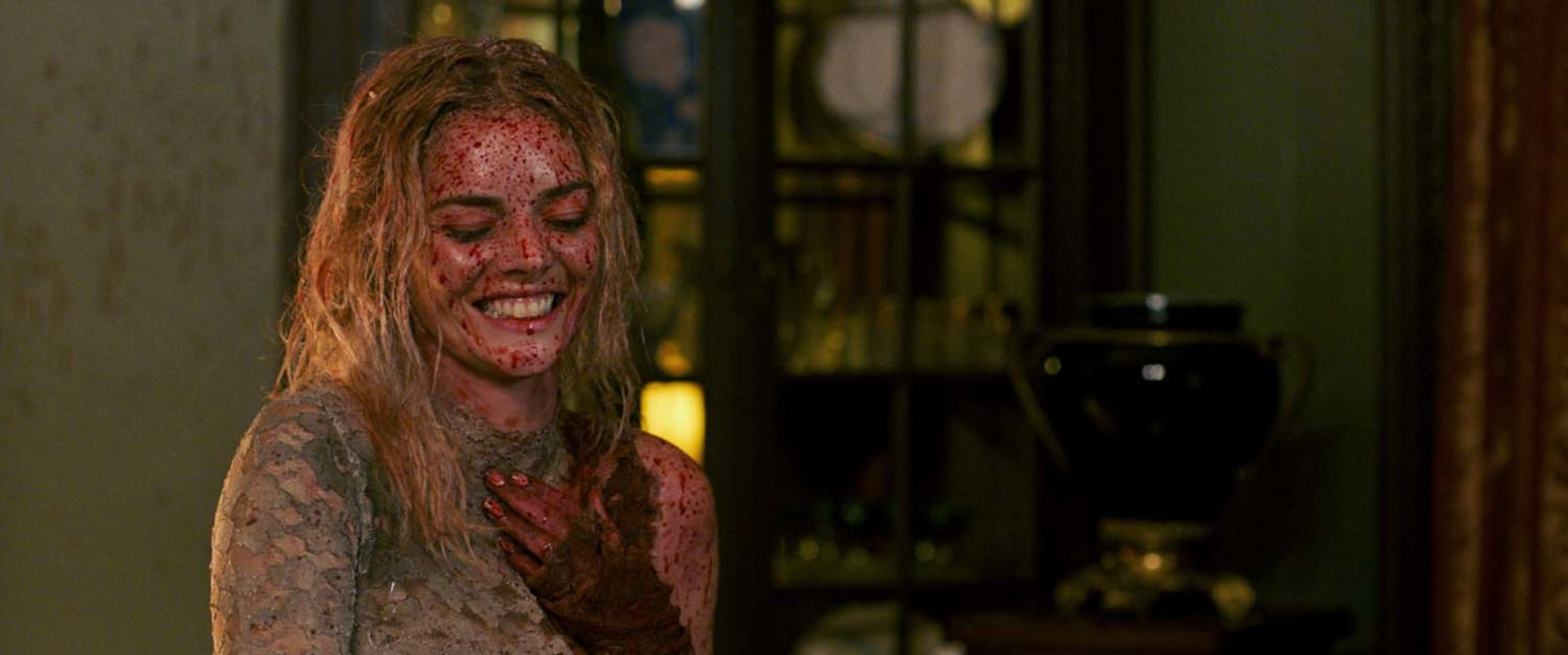 A blood-soaked Grace (Samara Weaving) laughs in 'Ready or Not'